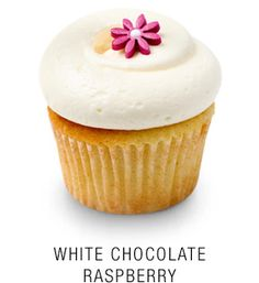 """""""White Chocolate Raspberry"""" Classic madagascar bourbon vanilla cupcake baked with fresh raspberries topped with a white chocolate buttercream frosting and a fondant flower"""