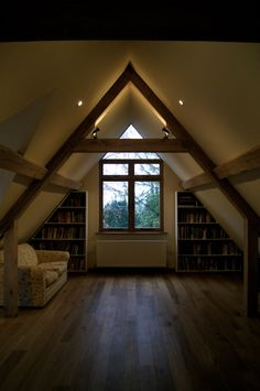 Spot lights on top of oak beams to light vaulted ceilings with warm white LED lamps. Lights by Jim Lawrence