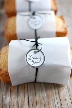 Tiny lemon bread loaves, I like the packaging. This would be cute wedding favors-do a bunch of difderent kinds of bread (banana bread? Bread Packaging, Dessert Packaging, Bakery Packaging, Gift Packaging, Packaging Ideas, Sandwich Packaging, Lemon Bread, Bakery Design, Pastry Shop