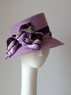 A custom felt hat with gorgeous silk and velvet ribbon we made for a client to showcase her vintage hat pin collection