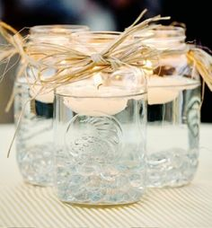 simple mason jars with floating candles- perfect for some candlelight