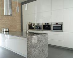 Modern kitchen with travertine wall