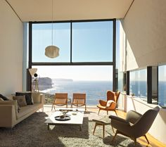A beautifully designed interior with a breathtaking view from the Holman House [NSW, Australia] Click for more stunning Australian beach houses...
