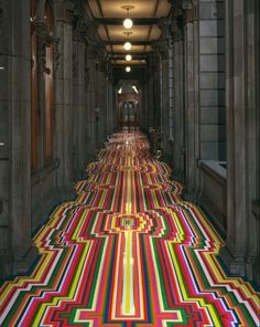Glasgow-based artist Jim Lambie can transform any space into a visual delight with his geometric tape designs.