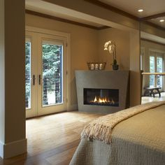 Sleek stone gray corner fireplace