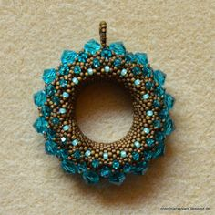 spARkLETT beads and paper bits: Golden Sun in Blue Zircon