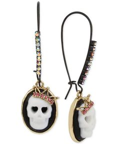 Definitely not your grandma's cameos. Fun-loving girls will adore these skull cameo drop earrings by Betsey Johnson with pink crystal detail. Designed in gold-tone and black-tone mixed metal. Approxim