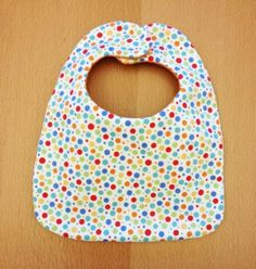 Perfect for a baby shower gift or for your own little one, this bib is easy to make out of your favorite fabrics.