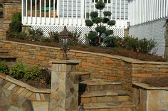 Retaining wall, staircase, and column with variegated Crab Orchard flagstone.