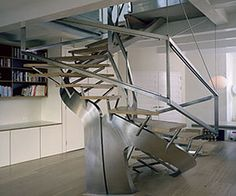Staircase crafted of wood and stainless steel by Thomas Laurens of Amsterdam.