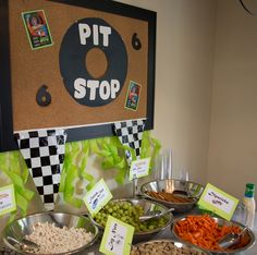 "Hot Wheels Party for J's 6th Birthday!  For the ""Pit Stop"" snack station, we served: Pit Stop Popcorn, Pit Stop Pretzels, Finish Line Fruit (green grapes), Lug Nuts (peanuts) & Dipsticks (baby carrots) with Racer Ranch."