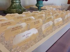 scalloped escort cards in diamond gem display http://www.theeventessentials.com/