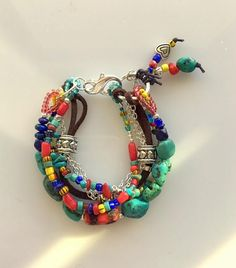 Colorful Multistrand Turquoise, Coral, Trade Beads, Silver and Leather Bracelet by MagicalUniverse on Etsy