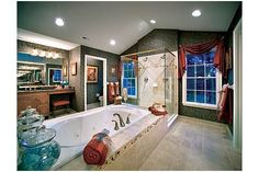 Massive windows frame this walk-in shower and tile-wrapped tub in this new home from Toll Brothers in the suburbs of New York City. The Chamberlain Model, in the community of Westchester Estates at Wilson Park.