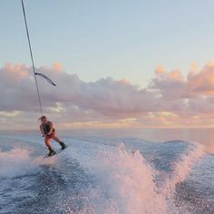 wakeboarding on the ocean   pink sunset   boat views