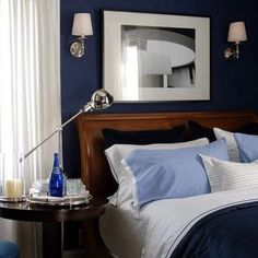Great, masculine bedroom.  Love that blue wall.