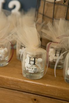 Shot glass favors filled with dinner mints and wrapped in tule - could be used as a votive holder as well.