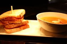 Traditions at the Williamsburg Lodge Restaurant Month Vegetable Bisque along side a hot ham and cheese sandwich.