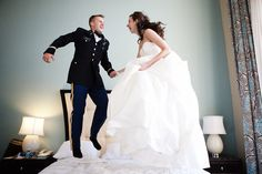 Jumping on the bed of the wedding night hotel- Cute Wedding Pic!