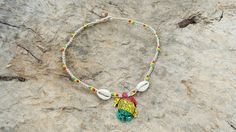 Check out this item in my Etsy shop https://www.etsy.com/listing/259308070/rasta-turtle-hemp-necklace-good-vibes