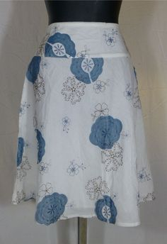 not this print (god, no) but this shape and the wide waistband. my favorite skirts are all this shape.