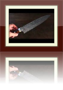 It is made of 16 Layers of Hand Hammered Damascus steel. The blade, appears darker in the picture, due to lighting conditions. When it is Hand-hammered, it reduces drag when cutting, keeping foods from sticking to the blade of the knife.