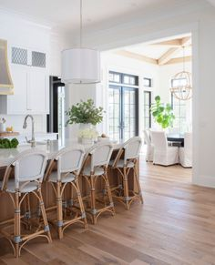 Southern Florida architecture meets midwestern charm in our latest home reveal. This stunning new build features organic tones and textures plus plenty of natural light. Explore Crow's Nest to learn White Farmhouse Kitchens, Home Kitchens, Kitchen White, Modern Farmhouse, White Dove Benjamin Moore Walls, White Oak Wood, Crow's Nest, White Cabinets, Cupboards