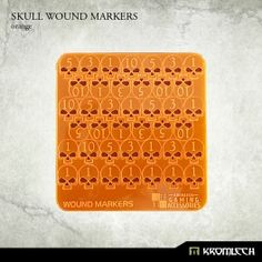 This set contains a plate with Skull Wound Markers made from orange fluorescent acrylic. There are 16 ones, 8 threes, 8 fives and 8 tens on a plate. Each Skull needs to be push out from the plate to use for your game.
