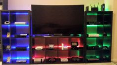 My video game setup showing 24 systems including handhelds.  Completely customized the Kallax IKEA shelving units rearranging the shelves, adding a painted panel board in back & installed LED strips - Feel free to reach out if you have any questions (phillips.kevin.patrick@gmail.com)
