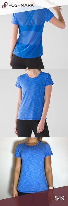 Lululemon 'Beat the Heat' Short Sleeve Lululemon 'Beat the Heat' Short Sleeve in Heathered Pipe Dream Blue / Pipe Dream Blue -No size tag/dot, but size 6.  -Mesh see-through back. -Like new, no flaws.  NO Trades. Please make all offers through offer button. lululemon athletica Tops Tees - Short Sleeve