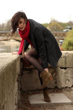 Shes got the best boots.. and her edgy hair is rad. french fashion bloggers have so much style..