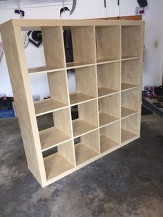 """Used (normal wear) - Cube bookcase with attachable desk. Ideal for storage, craft-room, playroom, bedroom or den! 16 cubes which are the perfect size for fabric storage bins. You can use the desk or not they come together.  Shelf measures about 58-1/3"""",58-1/3"""", 15-1/3""""deep. In good shape other than one spot on the face of the desk. The desk is predrilled to attach but the shelf is not. Comes with extra bracket we had used to attach to a bed instead."""