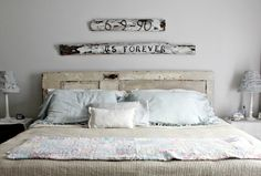 Beautiful old door headboard and white fencing signs