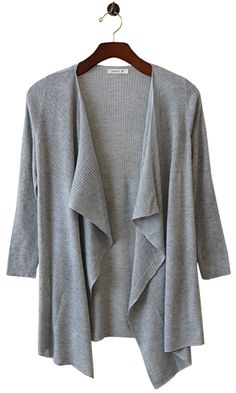 The perfect combination of easy chic and striking elegance, this lovely piece drapes beautifully and dresses up jeans with its neutral palette and modern take on grace.