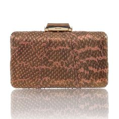 This classic Espey is covered in custom dyed Dusty Rose Elaphe snakeskin with Bronze mineral powder hand applied after, giving the clutch an etherial look. Featuring a Brass box casing that is covered by snakeskin, with a faceted clasp, KOTUR's signature brocade lining and a 30 cm drop-in shoulder chain. This compact minaudiere will fit evening essentials and an iPhone 6+   This item is made of exotic material and shipping time may vary, to allow for processing of appropriate customs…