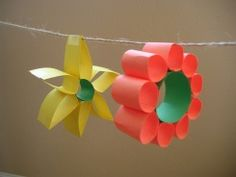 school age craft.  Just flowers made out of paper.  Tape together circles and cut paper into strips first.  Brilliant!  Hang on yarn to put up around the room. Paper Craft Supplies, Paper Crafts, Summer Crafts, Spring Crafts For Kids, Art For Kids, Flower Garlands, Paper Flowers For Kids, Paper Flower Decor, Craft Flowers