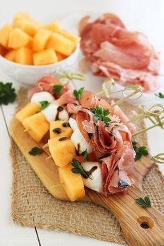Melon, Proscuitto and Mozzarella Skewers – These sweet and salty skewers with prosciutto, melon and creamy mozzarella are easy bites for any party!