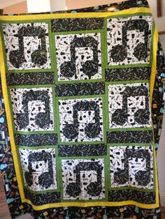 music note quilt  made with fabric from  from Blank Fabric Co.  The print is  small music symbols and instruments.