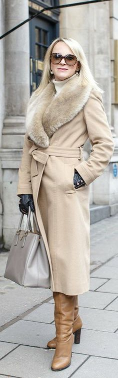 Jigsaw coat, a Prada bag, Aspinal of London gloves and Reiss boots.