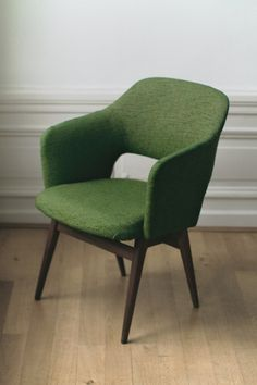 Beautiful green upholstered, dark wood curved back chair. Looks like an Eames's design. Great touch of color and period style to a room or an office.