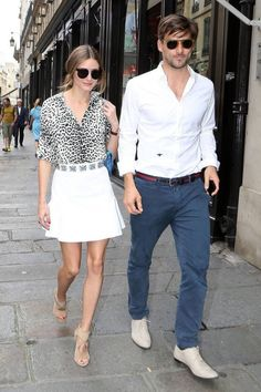 Such a power couple - Olivia Palermo in white mini skirt, leopard print blouse, and nude heels