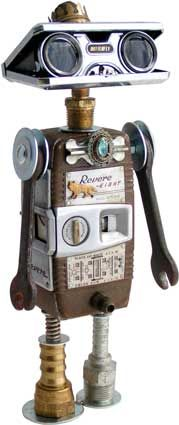 """Name: Schnabel  D.O.B.: 10/18/11  Height: 13""""  Principal Components: 8mm movie camera, opera glasses, wrenches, oil lamp burner, hydraulic fittings, jewelry, spring.  Amy Flynn Designs."""