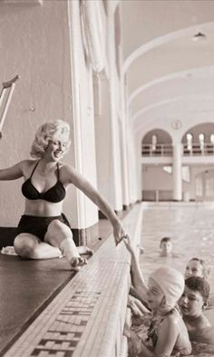 Actress Marilyn Monroe poolside at the Banff Springs Hotel in 1953. She twister her ankle while filming River of No Return//