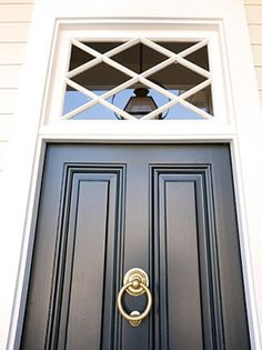 A black door paired with white molding and trim offers a look that is classic and bold.