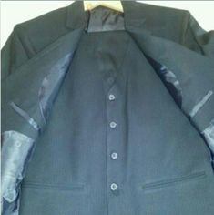 Beautifully designed men's suit Make your man fabulous!  Custom tailored NEW suit made of quality material w/ high design. Measurements: Chest: 40 Overarm: 50 Coat Sleeve inseam: 17.5 Coat Size: 42L Waist: 33 Hips: 38 Out seam: 41 SLENDER fit, high fashion suit. 3 piece, medium-weight material dark gray suit w/ a herringbone pattern. Two button front with pockets. Breast pocket. Four decorative buttons on sleeves. The vest is five button, adjustable sides. Hand Tailored Suits & Blazers Suits