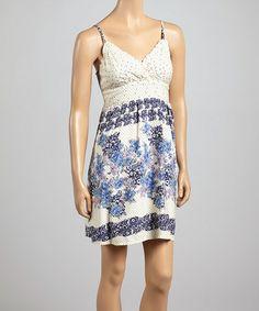 Look at this #zulilyfind! Navy Floral Pin Dot Surplice Dress #zulilyfinds