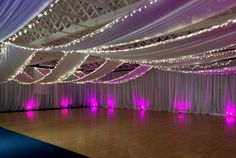 Uplighters and fairy lights iluminate our white drapes for a Craft Fair #wetransform