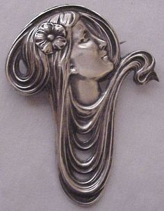 Unger Brothers Art Nouveau asymetrical sterling pin, woman with flowing hair