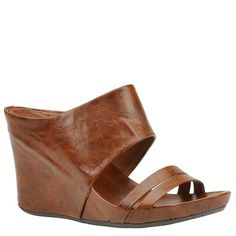"""Unlisted Webuary (Women's) - 9 M - Cognac Step-into comfort and versatile style give this sandal plenty of get-up-and-go. Synthetic upper. Lightly padded footbed. Manmade sole. 3-3/4"""" wedge heel."""