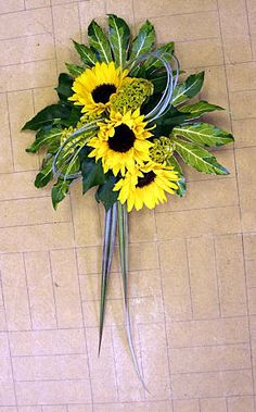 Sunflower Pew Bow Wall Arrangement - The freshness of yellow sunflowers used in this pew arrangement will brighten up any wall - how to